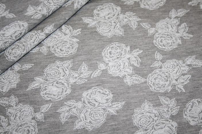 Jersey Stoff grau meliert Rosen weiß