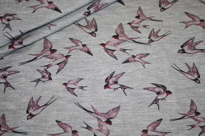 Jersey Stoff grau meliert Schwalben rosa