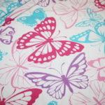 Jersey Stoff Schmetterling weiß bunt