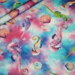 Digitaldruck Jersey Stoff Seepferdchen pink blau
