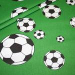 Baumwollstoff Fußball grün