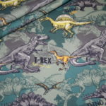 Jersey Stoff Dinos Dinosaurier grün