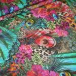 Stenzo Jersey Stoff Blumen Ranken Muster grün bunt
